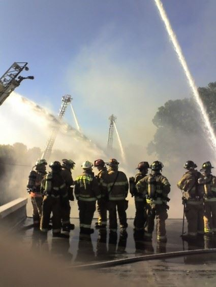 Fire fighters spraying water