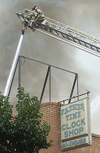 Fire in a brick building being sprayed with water