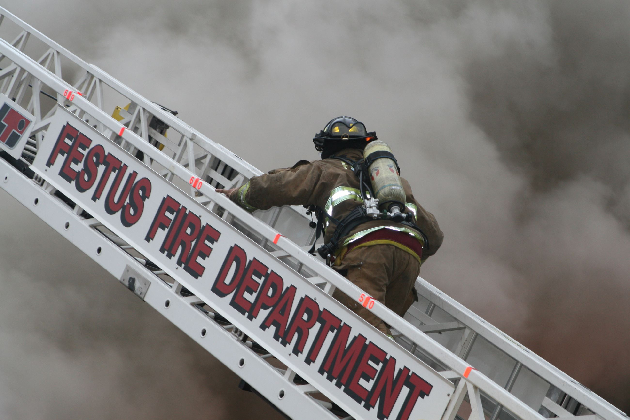 Fire fighter climbing the ladder