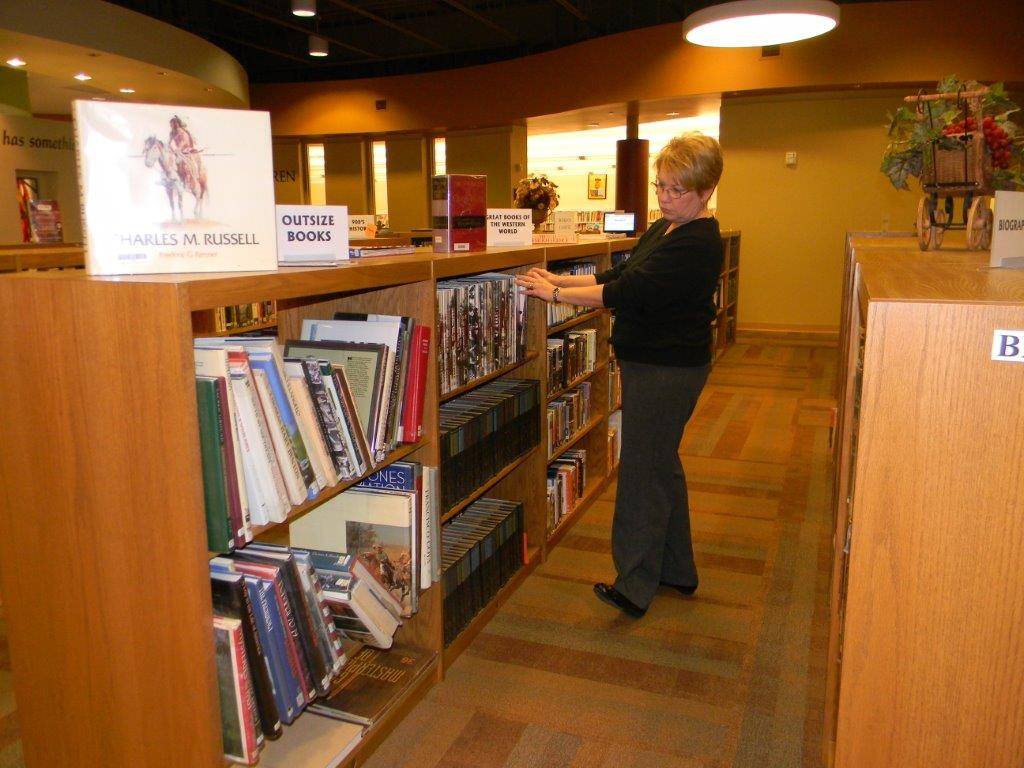 Woman looking through bookshelves