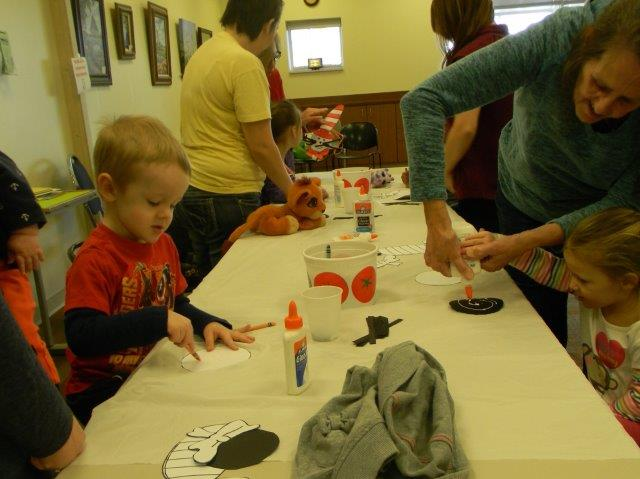 Adults and children doing crafts together