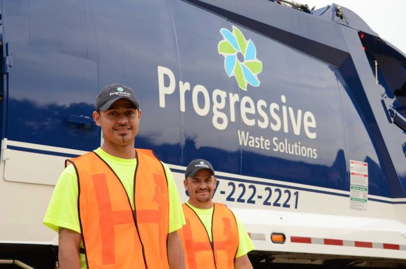 Men Standing by Progressive Waste Solutions Truck