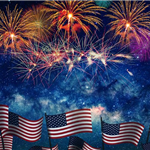 Fireworks Display with American flags across the bottom of the picture